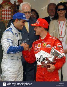 Stock Photo - (dpa) - Colombian formula one pilot Juan Pablo Montoya (L) congratulates third-placed Michael Schumacher (R, Ferrari) after the Grand Prix of Monaco in Monte Carlo, 1 June 2003