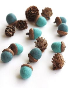 Mar 6, 2020 - A set of 10 medium sized felted acorns in shades of blue - turquoise and sea foam blue. Each felted acorns are hand felted using softly spun merino wool and then glued to real acorn caps. Use these as gift wrap garlands, decoration on your holiday table, or make your own necklaces (strand them Acorn Crafts, Felt Ball, Nature Crafts, Felt Flowers, Felt Crafts, Needle Felting, Wet Felting, Wool Felt, Felted Wool