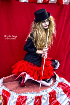 dark beauty spooky portrait gown dress creepy art photography model conceptual photo shoot white face paint circus top hair freakshow carnival red big top ring leader