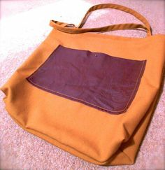 Another bag, I think I'm on a roll. It's a square mustard shopper with a large burgundy leather pocket & contrasting stitching. I used french seams so it looks pretty on the inside and boxed the bottom corners.