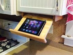 Under cabinet ipad/cookbook holder by TheYankeeBuilderShop on Etsy. Maybe order it unfinished so I can paint it to match my cabinets? Basic Kitchen, Kitchen Pantry, Diy Kitchen, Kitchen Gadgets, Kitchen Decor, Spanish Kitchen, Kitchen Counters, Kitchen Cupboards, Interior Design Kitchen