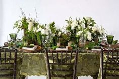 Dark and natural garden party decor table setting for an elegant outdoor gathering.