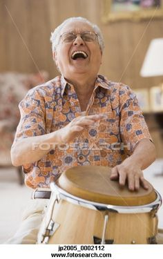 Laughter Is the Best Medicine. Think I will take up drumming if it makes you feel as good as he looks laughing