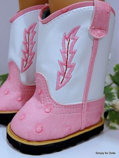 "I present to you this New pair of Pink & White Western Cowboy Boots Doll Shoes that fit most 18"" Dolls including the 18"" American Girl Dolls. They measure 3"" long by 1-3/4"" wide across the front pad by 3-3/4"" tall. 