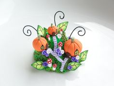 Miniature fairy pumpkin village made from polymer clay by fizzyclaret