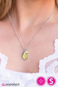Glassy yellow beading, a teardrop moonstone, and a star stamped charm swing from the bottom of a dainty satellite chain, creating a whimsically clustered pendan
