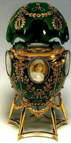 "1908 Alexander Palace Egg made for Nicholas II as a gift to his wife.  It contains five portraits of Czar Nicholas children.    Inside the egg is a tiny detailed replica of Aleksandr Palace ~ the Imperial family's favorite residence.  The inscription ""The Palace at Czarskoye Selo"" enclosed in a laurel wreath, is engraved on the base.  In 1917 the egg was transferred to the Moscow Kremlin Armoury where it remains today."