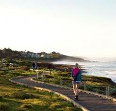 Cambria in AAA Via Magazine: (Woman on boardwalk at Moonstone Beach in Cambria, Calif., image)