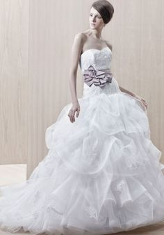 Gown features lace bodice and detachable ribbon belt.