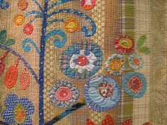 From blog post about applique on display at quilt market -- Piece O Cake designs / Becky Goldsmith