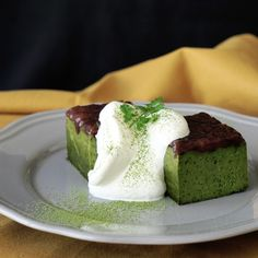 A rich, sweet dessert made with a few unexpected ingredients.. Ingredients: 25 grams matcha powder, sifted, 200 ml heavy cream, 90 grams white chocolate, 30 grams butter, 1 egg yolk, 1 whole egg, 1 tbsp flour, sifted, 100 grams prepared sweetened adzuki beans