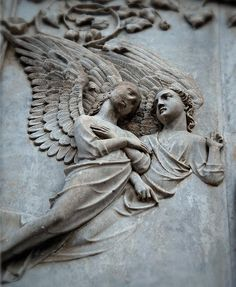 two angels.....    .  A detail of the amazing sculptural façade of the cathedral in Orvieto, Italy.