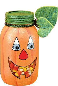 I love it!  Painted mason jar and you can see the candy through his mouth!