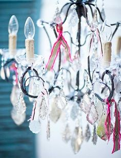 Love the little bits of ribbon tied to this chandelier