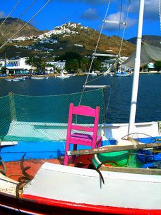 Chair on a boat with view of Serifos , Greece