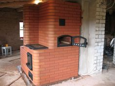 russian fireplace with pizza oven | The Russian fireplace above has cooking surface above the firebox and stove top type surface