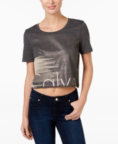 Show off your urban-chic sensibilities in Calvin Klein Jeans' sexy casual crop top. | Cotton/polyester | Machine washable | Imported | Crew neckline | Pullover styling | Logo graphic at front | Loose