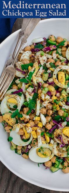 Mediterranean Chickpea Egg Salad Recipe | The Mediterranean Dish. A simple, satisfying egg salad prepared Mediterranean style with fresh veggies, herbs, and a zesty dressing! From TheMediterraneanDish.com