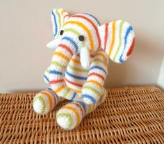 Herbert the hand knitted jointed elephant in red, yellow, blue and green stripes. With a long bendy trunk. Heirloom quality - MADE TO ORDER. £25.00, via Etsy.