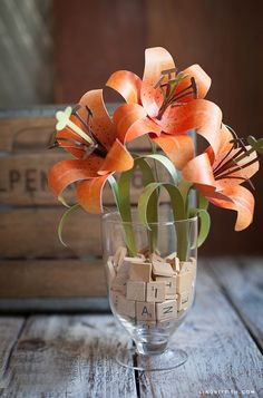 You can make these paper flowers yourself with cardstock and a color printer. Learn how from Lia Griffith.