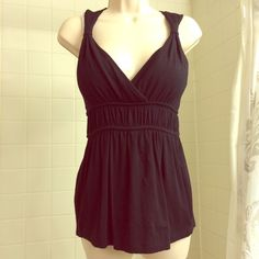 Strappy Black Faux Wrap Empire Waist Babydoll Top Cute and sexy Black Babydoll tank with empire waist and faux wrap detail. Beautiful straps. Super soft and cute! Preloved and in excellent condition! Saks Fifth Avenue Tops
