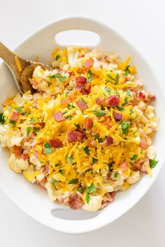 This ultimate cheesy cauliflower is amazingly bacony and full of so much flavor! No more bland cauliflower! Just creamy cheese sauce and salty bacon goodness