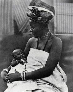 Bamun Kingdom, Cameroon PRINCESS NGUTANE cradles her firstborn son, AMIDOU MOUNDE who was born in 1915