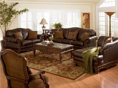 leather living room sets on the wooden table