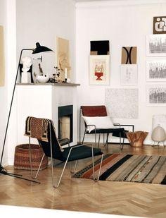 Earthy Artsy Living Room With Herringbone Floors And Modern Furnishings
