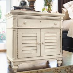 White Farmhouse Nightstand from Wayfair Add an old-world charm to your bedroom decor with this worn country styled nightstand.