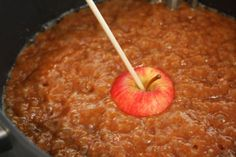 Set up a warmer and let your guests magically turn apples into carmel apples - would work well with large slices for smaller guests.  Provide nuts and cookie pieces to roll them in.