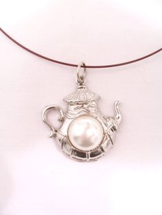 Metal and pearl teapot pendant on cable wire necklace by SparkleandComfort, $12.99