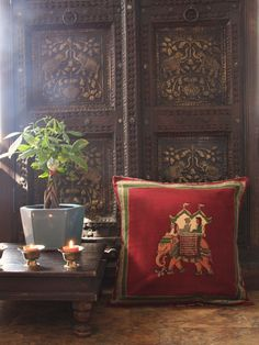 Indian design is often typified by intricately patterned textiles (usually with gold accents), arched furniture, mosaic prints and tiles, and colors like bright blues, reds, oranges and golds. Photo courtesy of Saffron Marigold.