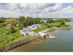 Ranch, Single Family - Charlestown, RI - LuxuryRealEstate.com™ - Extraordinary WATERFRONT offering on over 1 ACRE featuring sheer coastal elegance with this exquisite property which includes a MAIN HOUSE, w/ 2 bedrooms and 2179 sq feet, GUEST HOUSE with 3 bedrooms,. BOAT HOUSE, DOCK- SIMPLY GORGEOUS--ONE OF A KIND
