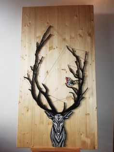 The Robin and The Stag. String Art of a protective deer <3 Standing tall at 1500×800 cm, this is by far the biggest object we've done. It's the tale of a robin seeking refuge in the stag's horns, but in the end becoming too afraid to ever leave the comfort zone he created. It's one of our more customer specific designs, hope you enjoy it!