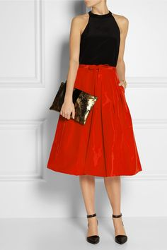 TIBI Pleated silk-faille skirt $525 Crafted from crimson silk-faille, Tibi's pleated full skirt is an elegant way to work bold color into your wardrobe. We love it with a black blouse and monochrome accessories, but it's equally chic with a striped top.  Shown here with: Maria Black earrings, bracelet and ring, Tibi top, Arme De L'Amour bracelets, Monica Vinader ring, Alexander Wang shoes, Clare Vivier clutch.