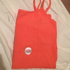 Coral Cami Orangish coral color cami from express. Shelf bra built in. Adjustable shoulder straps. Size small. New with tags. No trades. Express Tops Tank Tops