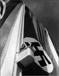 """Leni Riefenstahl, a revolutionary film director, accesses an ambitious camera angle that overlooks an NSDAP Party Congress Rally in Nürnberg as part of the groundbreaking documentary titled """"Triumph of the Will"""" which provided an exciting view inside the new National Socialist German Reich under Hitler's revolutionary leadership."""