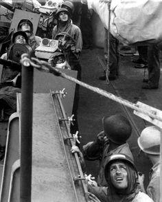 American sailors looking skyward