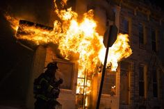 A building in Baltimore on fire during upheaval just hours after a funeral for Freddie Gray.