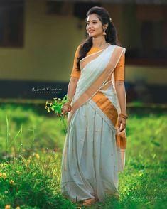 Image may contain: 1 person, standing and outdoor Lehenga Designs, Kerala Saree Blouse Designs, Half Saree Designs, Set Saree, Half Saree Lehenga, Saree Look, Lehenga Gown, Beautiful Girl Indian, Beautiful Saree
