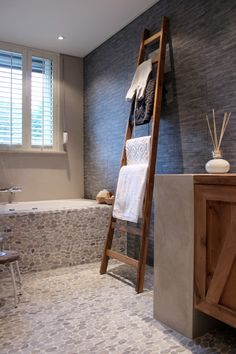 Sliced Java Tan pebble tile bathroom floor and tub surround. Also Grey Pencil Stone Mosaic wall tile http://www.pebbletileshop.com/products/Grey-Pencil-Stone-Mosaic-Tile.html#.VEAoMPldWJc