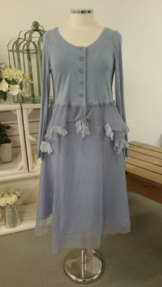 The Out of Xile Flower Backed Cardigan is delightfully feminine It has a jersey top with sheer organza skirt trimmed with silk flowers The