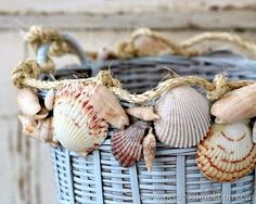 Basket makeover with blue paint, shells and rope! Featured on CC: http://www.completely-coastal.com/2015/07/revamp-basket-paint-shells.html