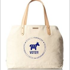 Vote! Democrat canvas tote Rebecca Minkoff Democrat donkey canvas tote.  I just hand-washed it so it has some wrinkles.  There are a few spots on the cloth.  Also, there's a large blue area on the back of the bag rubbed off from my jeans.  I got a lot of the color out but it's still there.   The straps are leather so I didn't put this in the wash. Dry cleaning will get that out. Rebecca Minkoff Bags