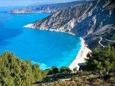 Mirtos Beach in Argostoli Greece- look for the blue striped umbrellas on the beach.