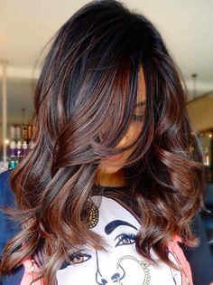 Your next hair color is inspired by your favorite coffee drink. Cold brew is the fall trend for dark brunettes who want warm highlights of red and gold.