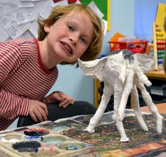 Pupil and his elephant. Long Legged Animals by Years 3 & 4 Making Club at www.accessart.org.uk