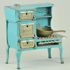 """KENT"" GAS RANGE  Largest of Kenton's stoves in 1927, painted in blue with extensive nickel parts, embossed ""Kent"" on oven door."