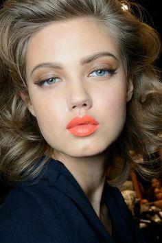 orange/peach lipstick and full curls
